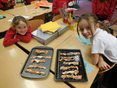Ellie Moreton and Carly Bithel made pizza twirls in cooking club.